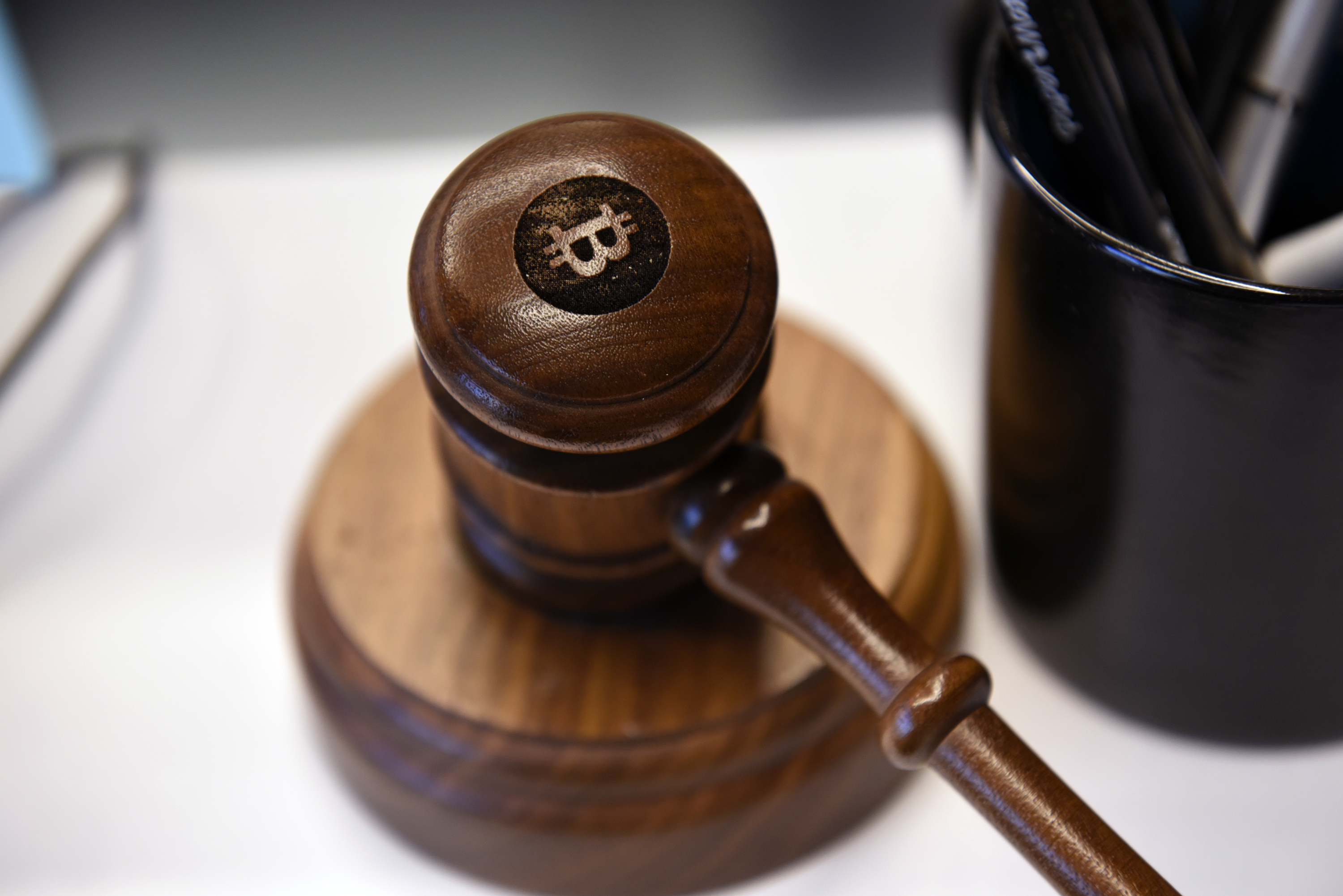 A Bitcoin gavel is seen on a desk at the Coinbase Inc. office in San Francisco, California, U.S., on Friday, Dec. 1, 2017. Coinbase wants to use digital money to reinvent finance. In the company's version of the future, loans, venture capital, money transfers, accounts receivable and stock trading can all be done with electronic currency, using Coinbase instead of banks. Photographer: Michael Short/Bloomberg